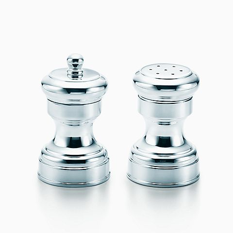 Capstan salt and pepper shakers in sterling silver.