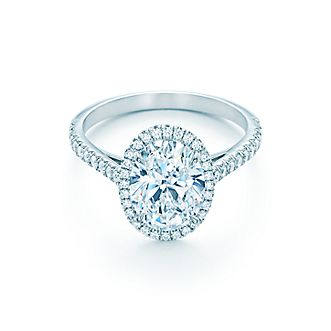 Radiating a light all its own, a crown of diamonds surrounds a stunning  center stone.