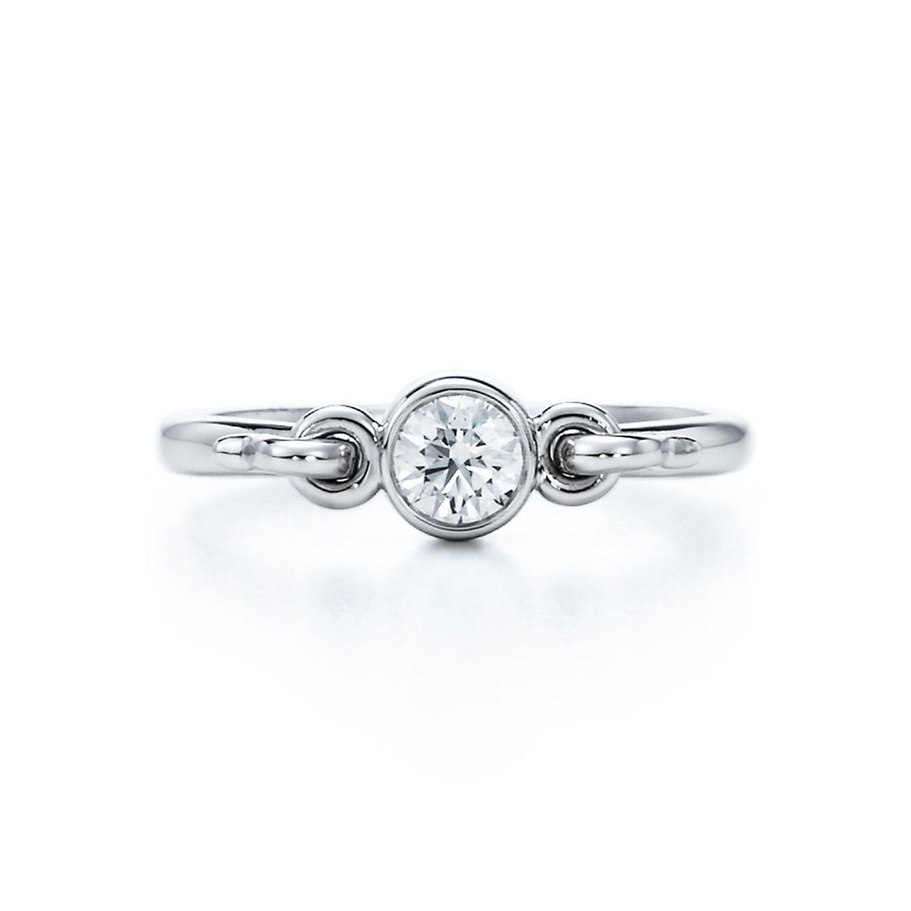 Elsa Peretti® Swan ring with a diamond in platinum.   Tiffany & Co.