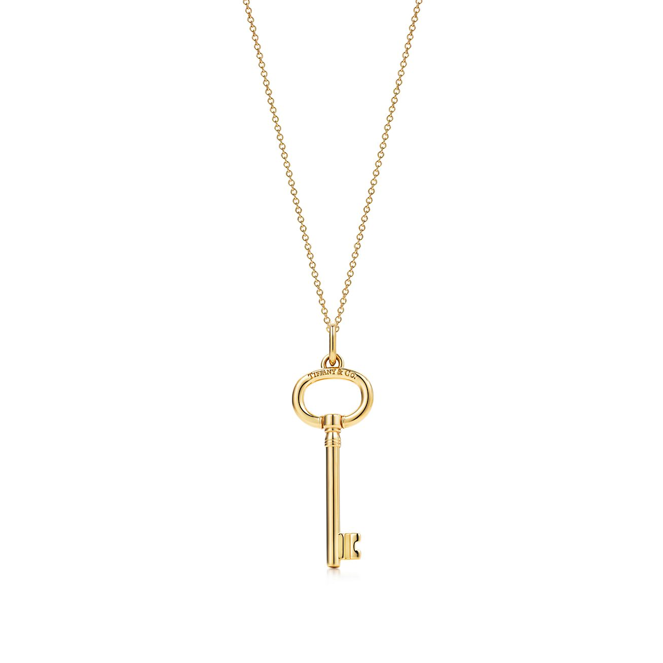 Tiffany Keys oval key pendant in 18k gold on a chain. | Tiffany & Co.