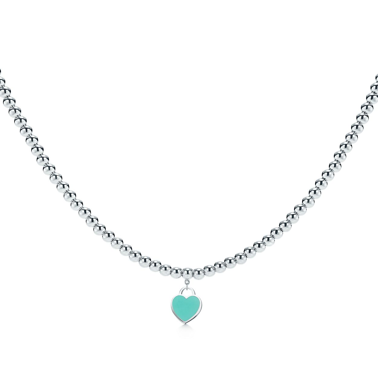 Return to Tiffany® heart tag necklace in sterling silver on a ...
