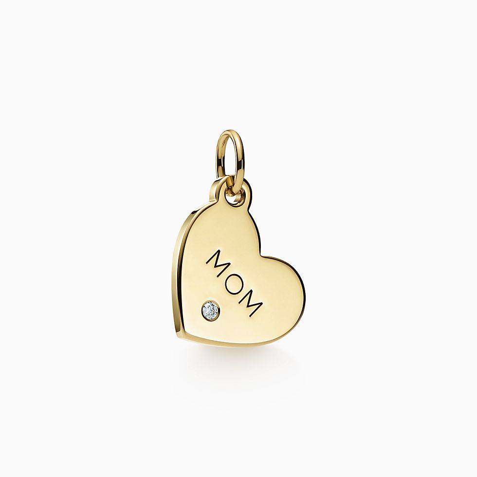 Tiffany co official luxury jewelry gifts accessories since drop a hint for tiffany charms mom tag in 18k gold with a diamond miniop now for tiffany charms mom tag in 18k gold with a diamond mini negle Images