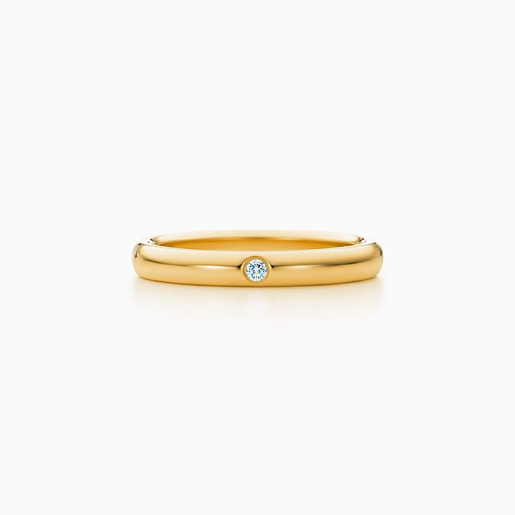 New Elsa Peretti® band ring with a diamond in 18k gold.
