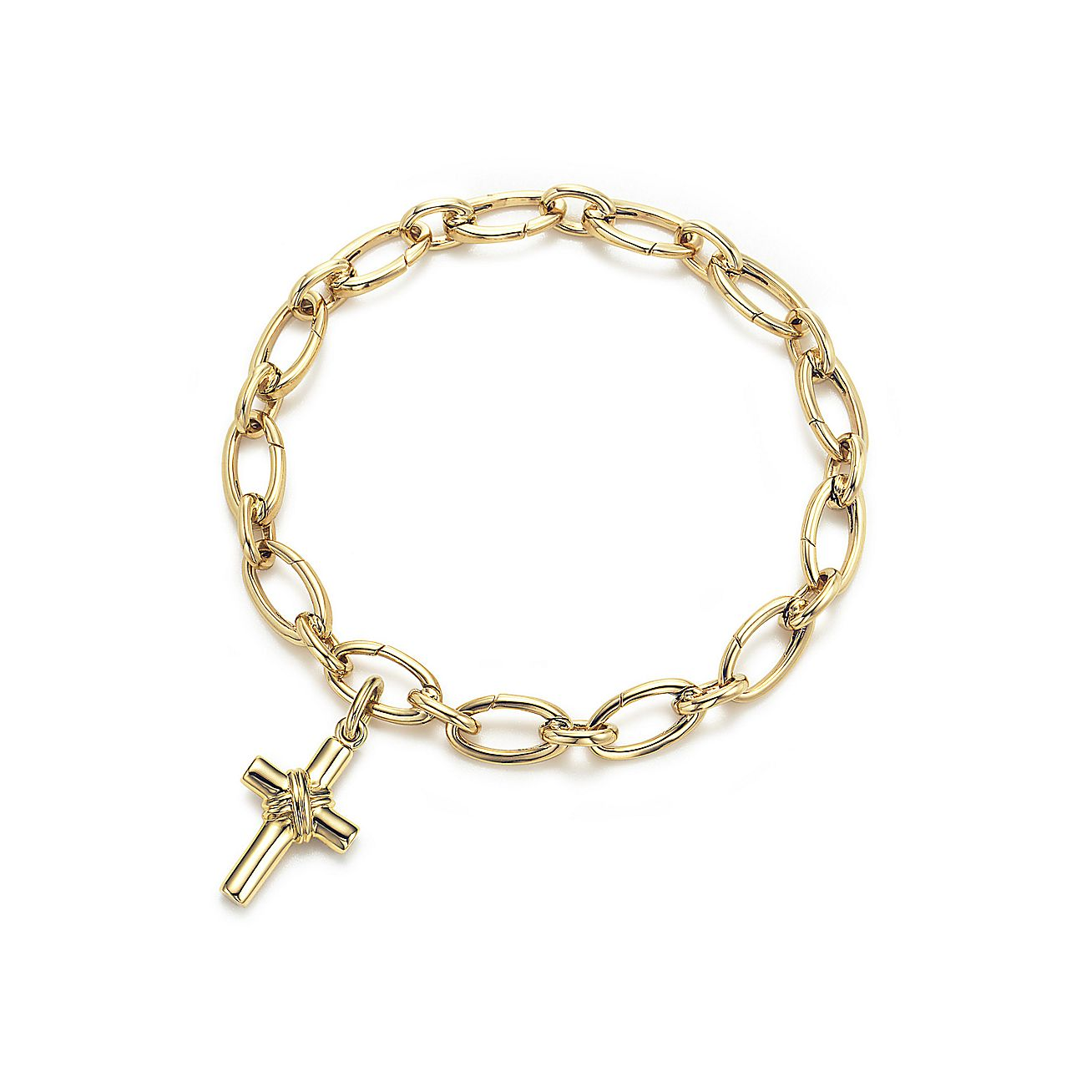 Cross Charm Bracelet: Cross Charm. 18k Gold. On A Bracelet.