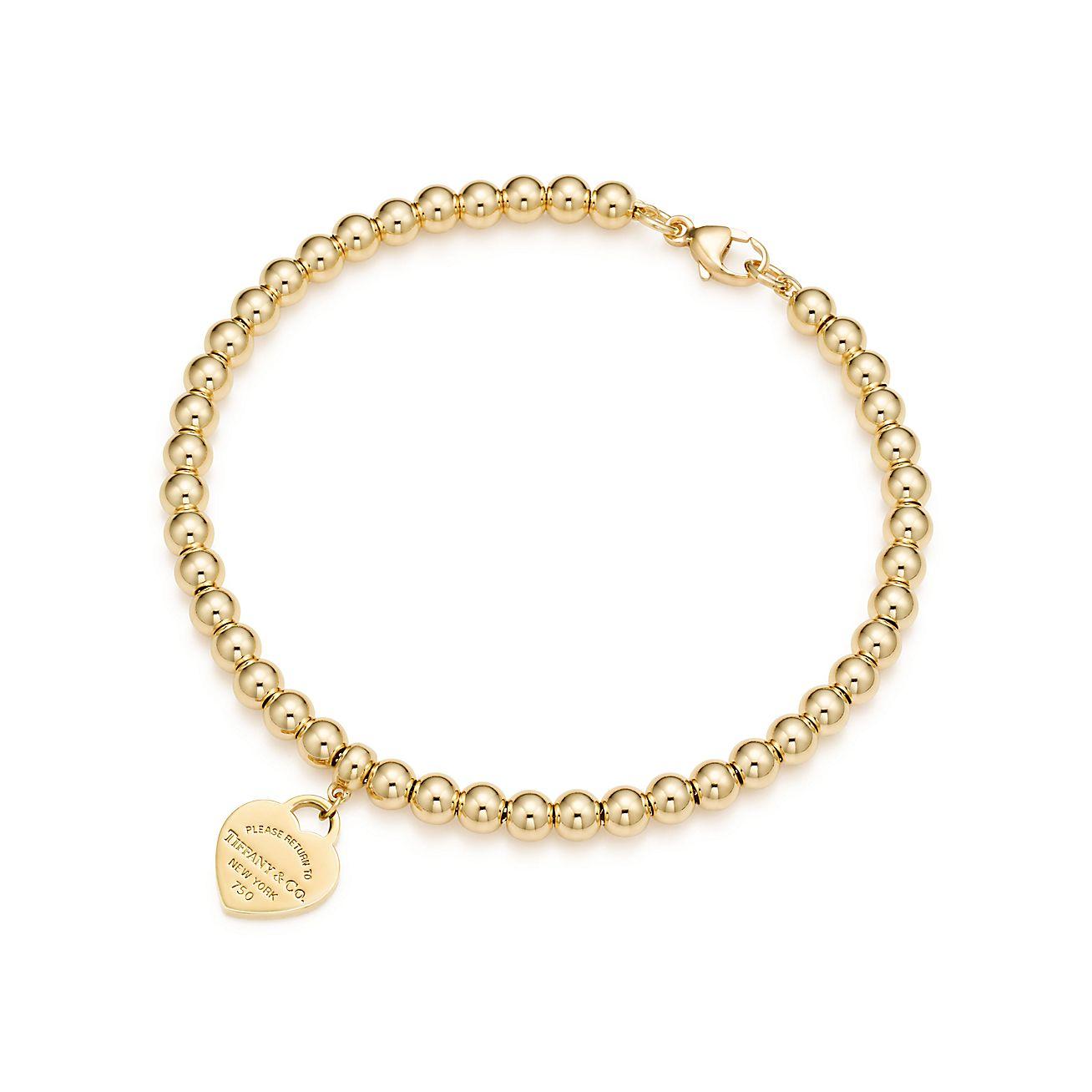 Brazalete con cuentas y placa mini estilo corazón en oro de 18 quilates, mediano | Tiffany & Co.