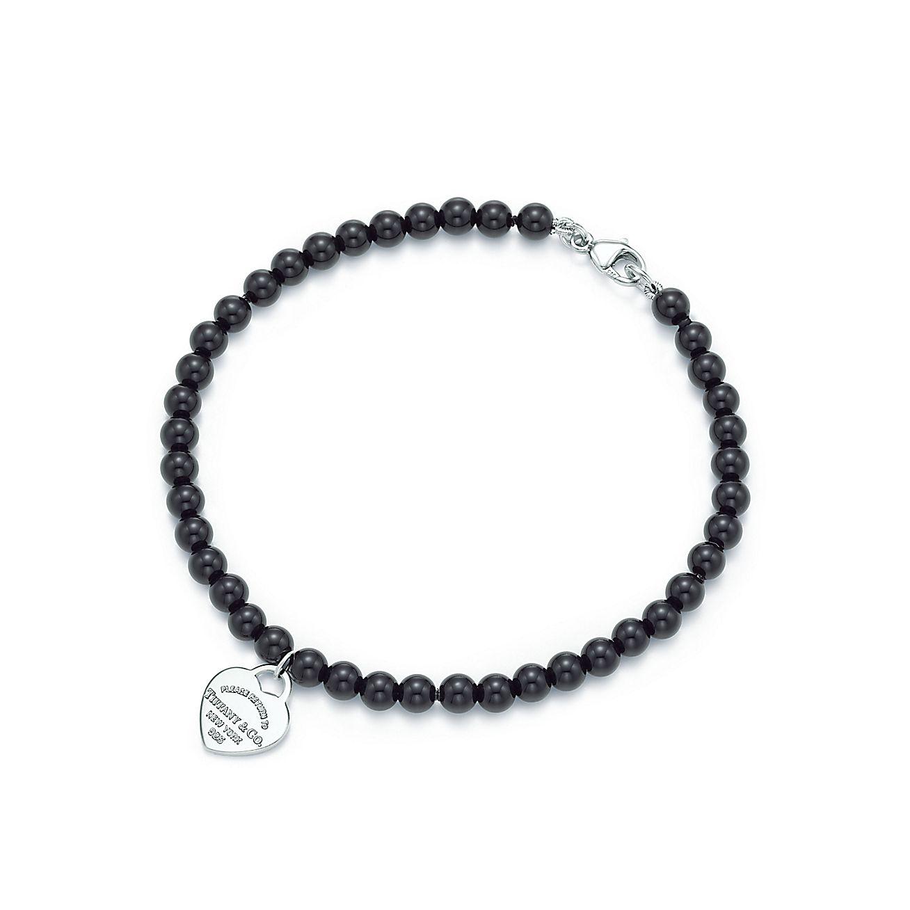 Return To Tiffany Mini Heart Tag In Silver On A Black
