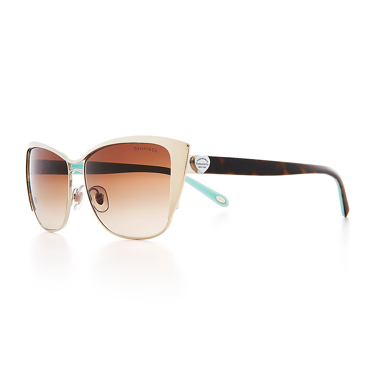 e5b2b49238a3 Return to Tiffany® cat eye sunglasses in pale gold-colored metal and  acetate.