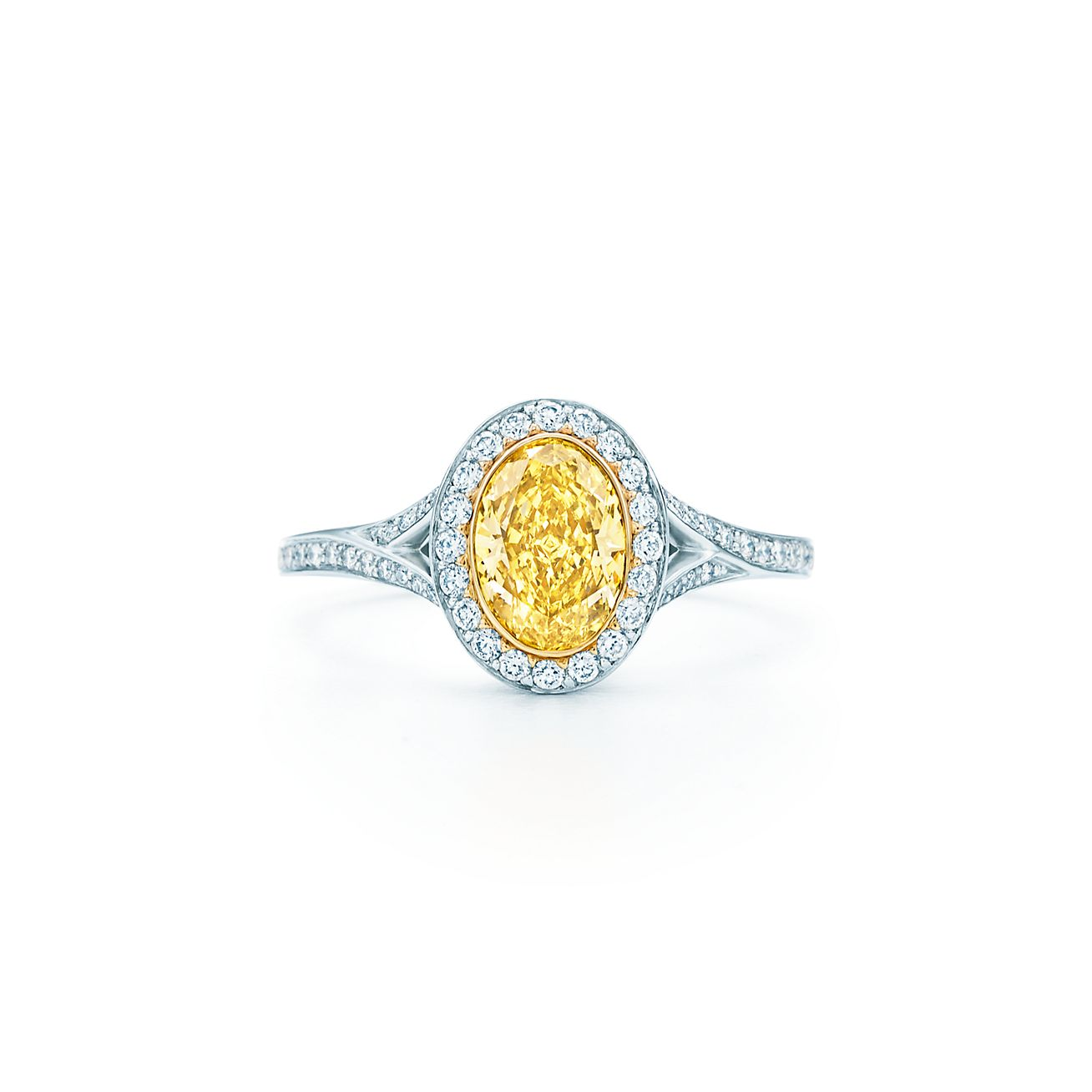yellow diamond crossover ring in platinum and 18k gold