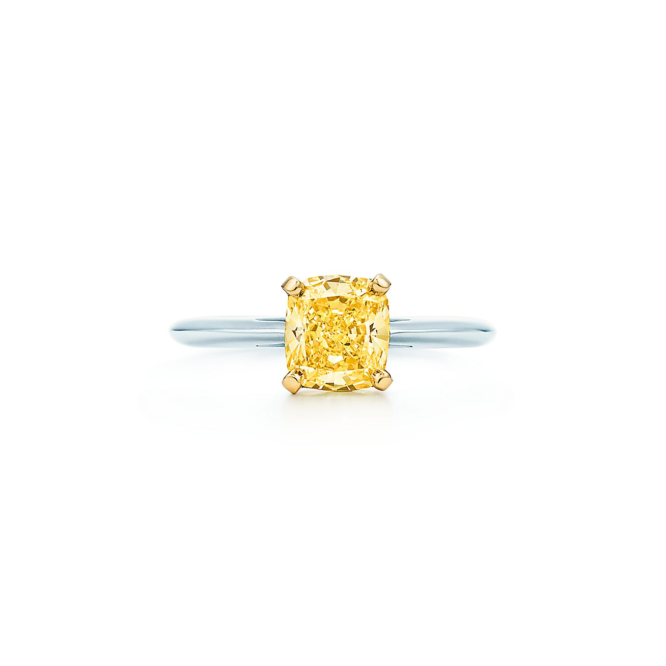 Ring In Platinum With A Cushion Cut Yellow Diamond
