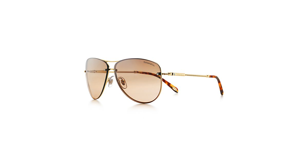 aviators glasses kmm7  Tiffany Twist aviator sunglasses in gold-colored metal with Austrian  crystals  Tiffany & Co