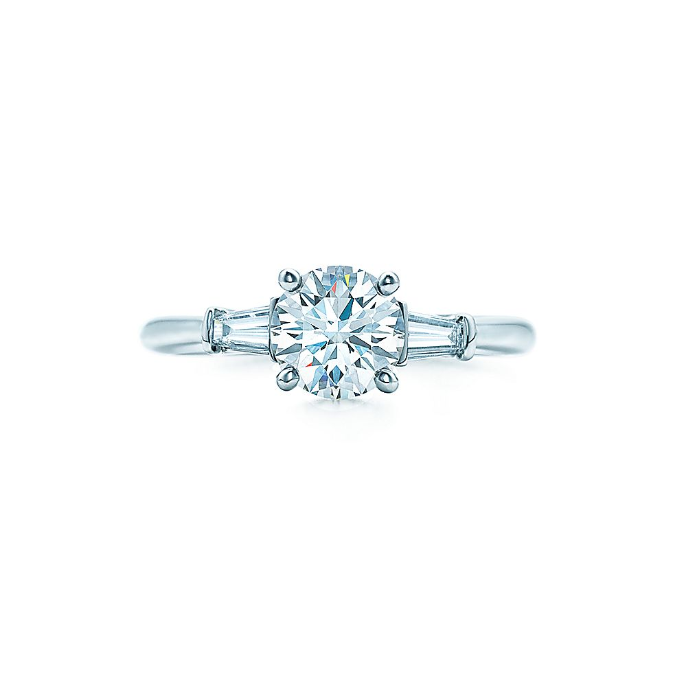 Round Brilliant With Tapered Baguettes Engagement Rings