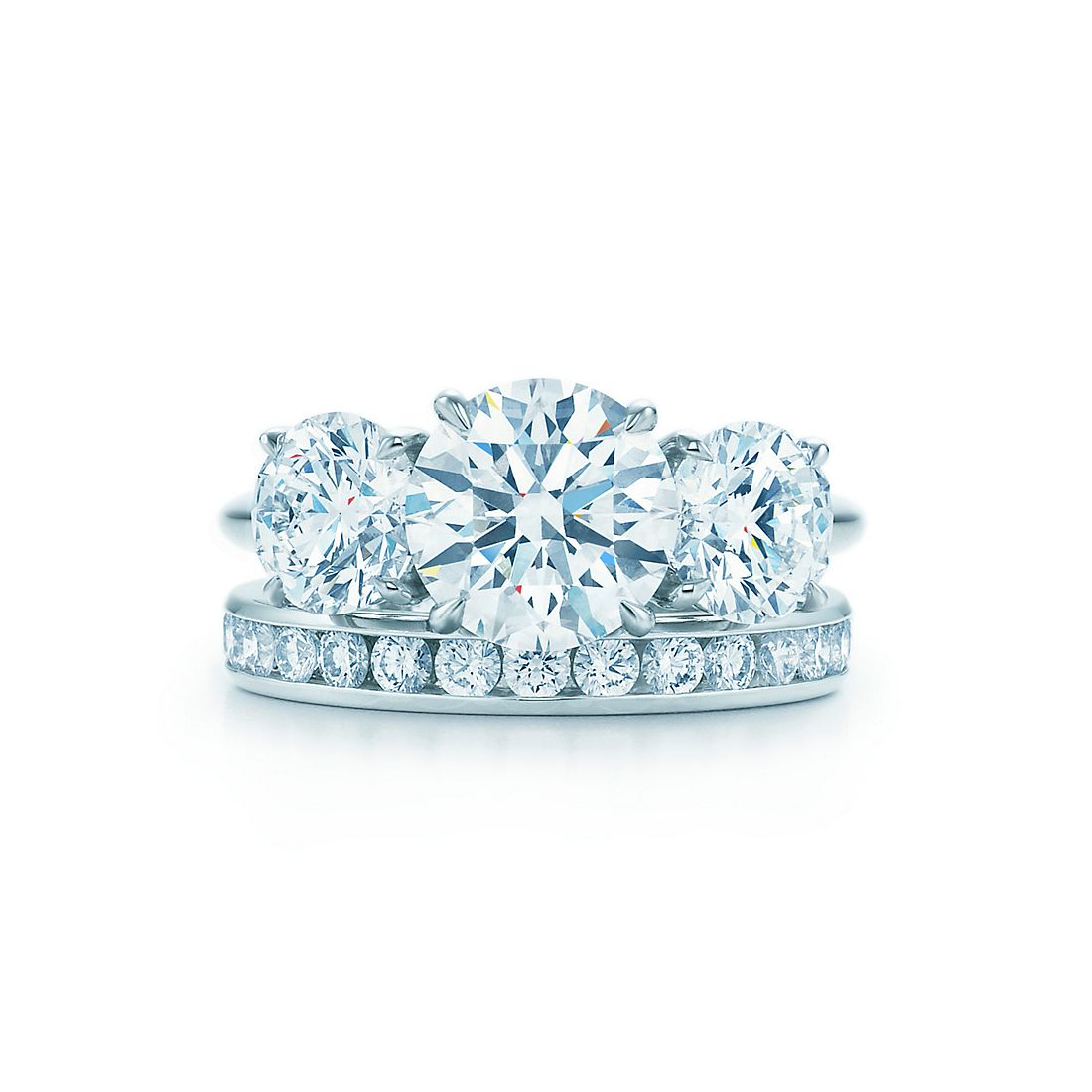 23 ct shown with tiffany diamond wedding band - Three Stone Wedding Rings