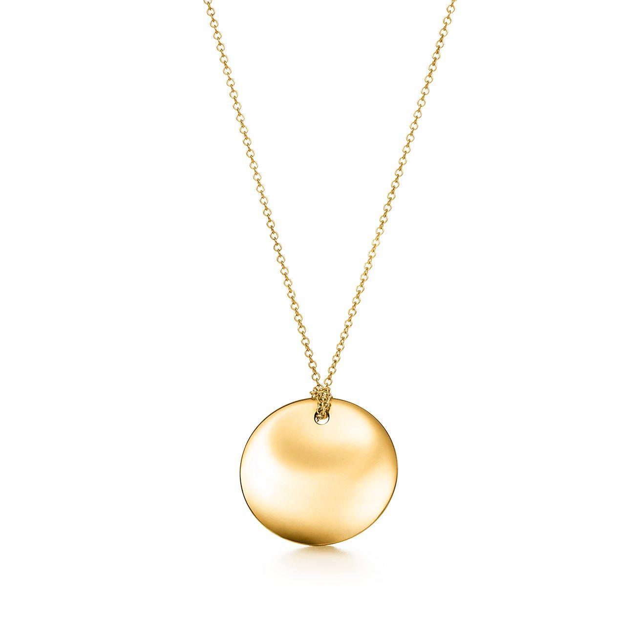 Elsa Peretti® Round pendant in 18k gold.  7fcab9ec9c