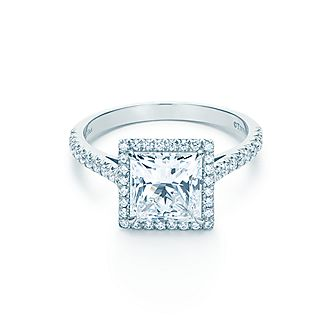 A Dazzling Center Stone Surrounded By Luminous Halo Of Bead Set Diamonds Tiffany Soleste Wedding Bands Directional Right