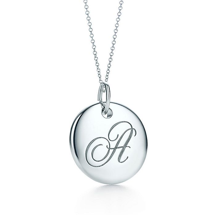 09cc04292 Tiffany Notes alphabet disc charm in silver on a chain. Letters A-Z ...