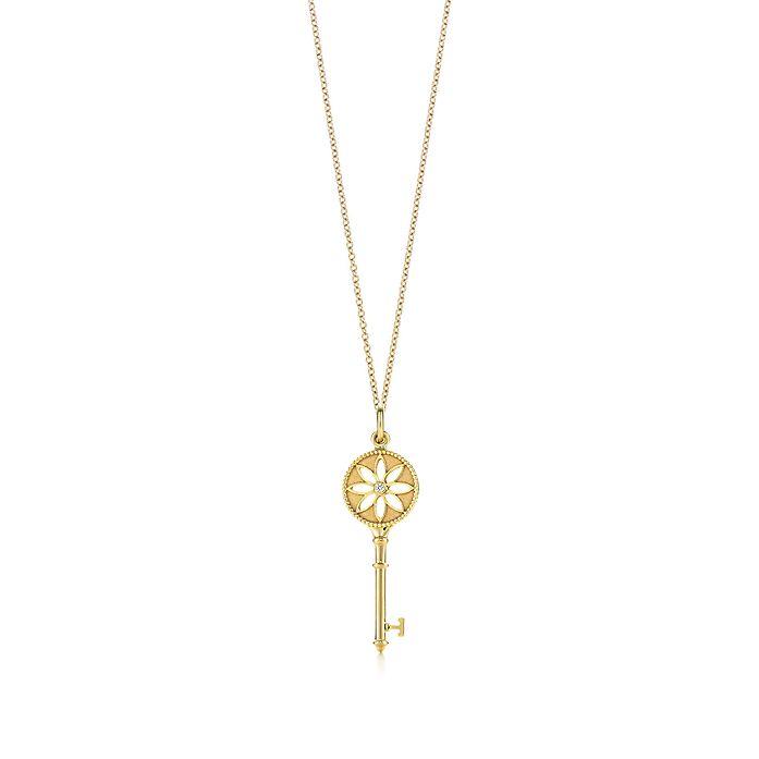 64da71547 Tiffany Keys daisy key pendant in 18k gold with a diamond on a chain ...