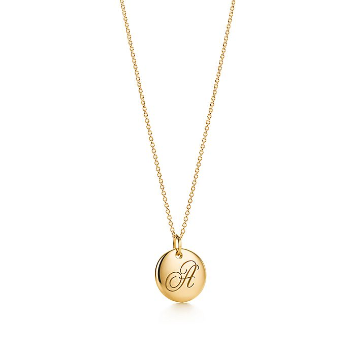 72a4ef03d Tiffany Notes alphabet disc charm in 18k gold, small. Letters A-Z ...