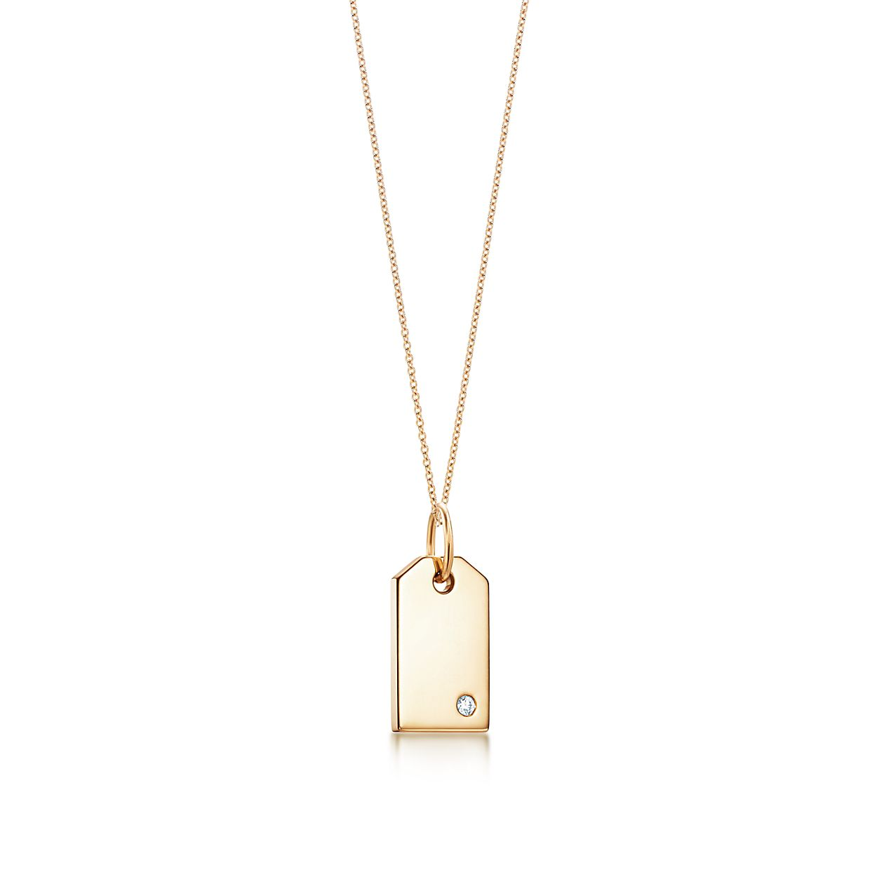 tiffany charms tag in 18k gold with a diamond mini tiffany co