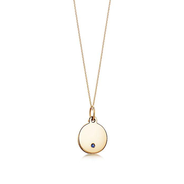 da898569e Tiffany Charms round tag in 18k gold with a sapphire, mini ...
