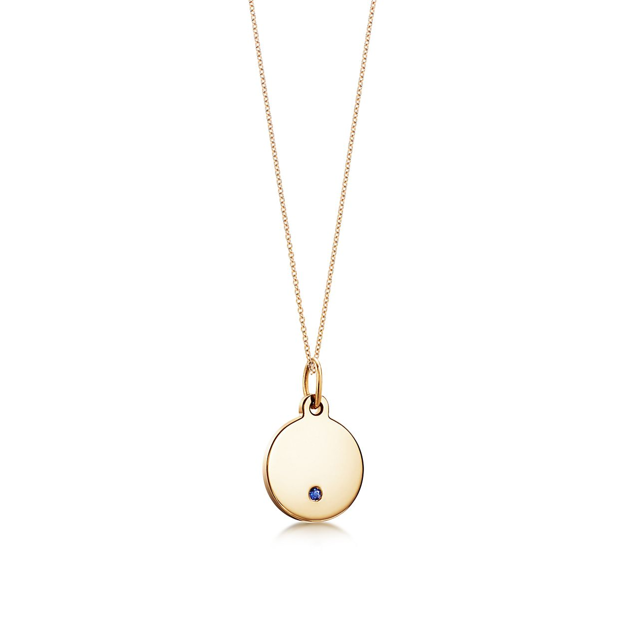 a865d9e9e643 Tiffany Charms round tag in 18k gold with a sapphire