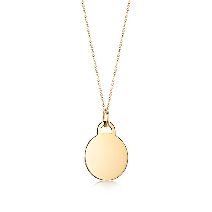 7d3eb640f Tiffany Charms round tag charm in 18k gold, large.   Tiffany & Co.