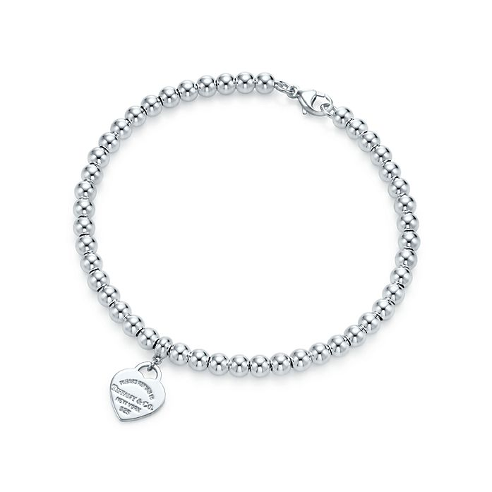 a0bd07e66be Return to Tiffany® mini heart tag in sterling silver on a bead ...