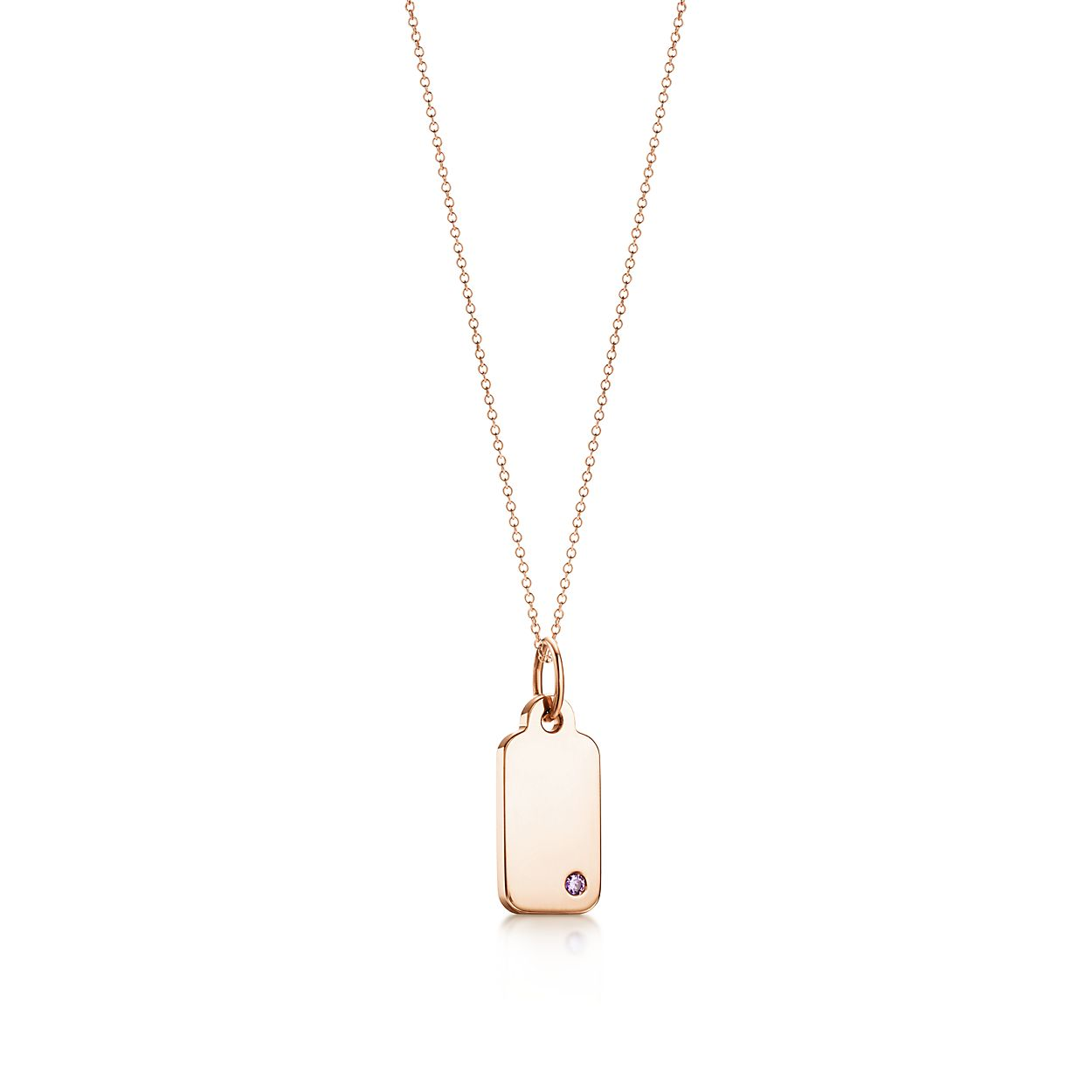Tiffany Charms tag in 18k gold with a diamond, mini Tiffany & Co.