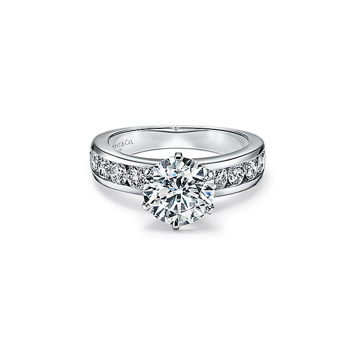 The Tiffany Setting Engagement Ring With A Channel Set Diamond Band In Platinum