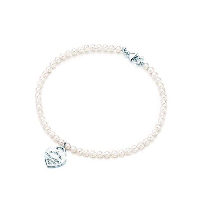 d864b6f6b Return to Tiffany™ mini heart tag in silver on a freshwater pearl ...