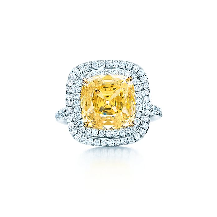 b9423c18409 Square yellow diamond ring with white diamonds in 18k gold and platinum.