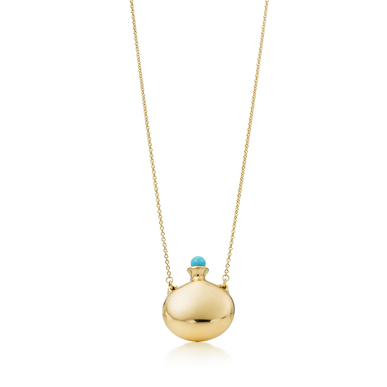 Elsa Peretti Open Heart pendant of turquoise and 18k gold Tiffany & Co.