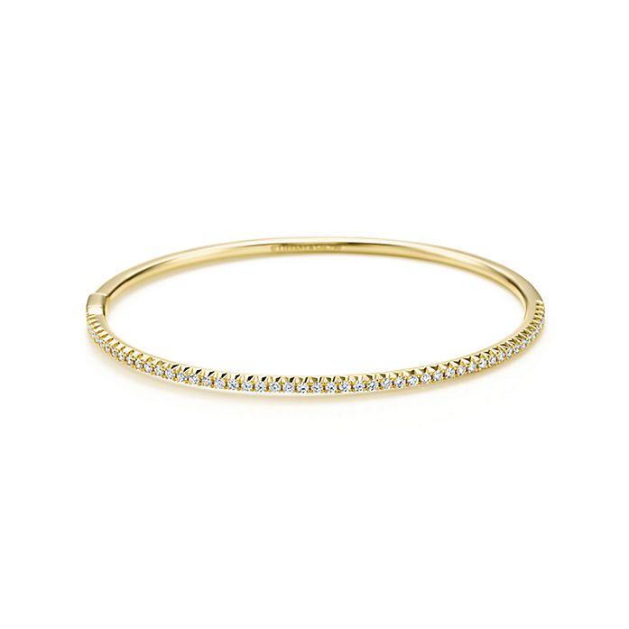 68b00f879 Tiffany Metro hinged bangle in 18k gold with diamonds, medium ...