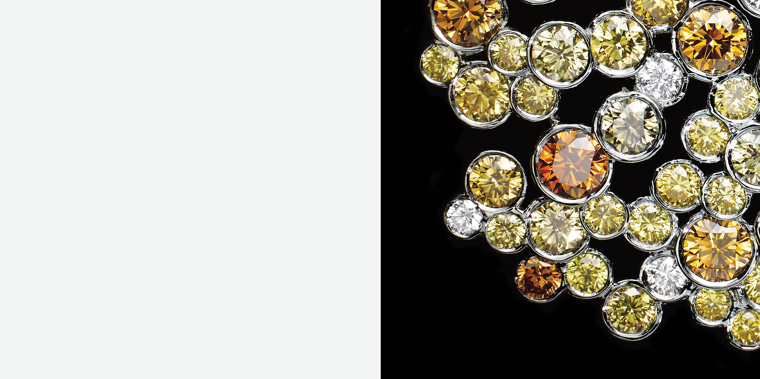 Earrings in platinum with round yellow and white diamonds