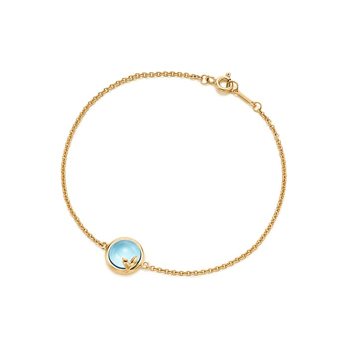 d1bfcbff2 Paloma Picasso® Olive Leaf bracelet in 18k gold with a blue topaz ...