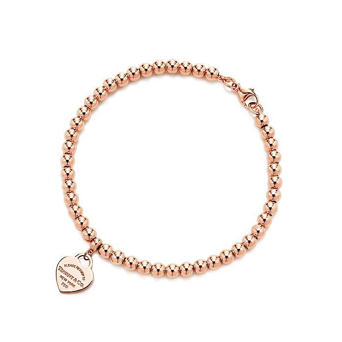 1dd4e2fc975 Return to Tiffany™ mini heart tag in 18k rose gold on a bead ...