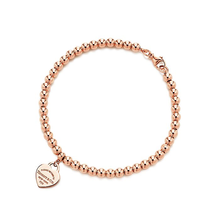 6de874e47 Return to Tiffany™ mini heart tag in 18k rose gold on a bead ...