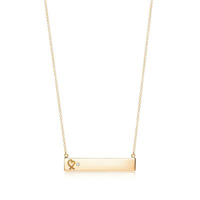 Paloma Picasso Loving Heart bar pendant in 18k gold with a diamond
