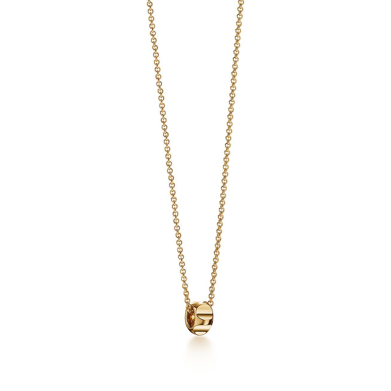 Palomas groove bead pendant in 18k gold tiffany co palomas groovebead pendant aloadofball Images