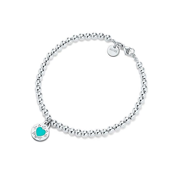 5c3ef11ef Return to Tiffany™ round heart charm in silver on a bead bracelet ...