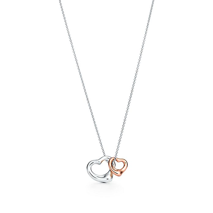 7502b84c3 Elsa Peretti® Open Heart pendant in silver and 18k rose gold, extra ...