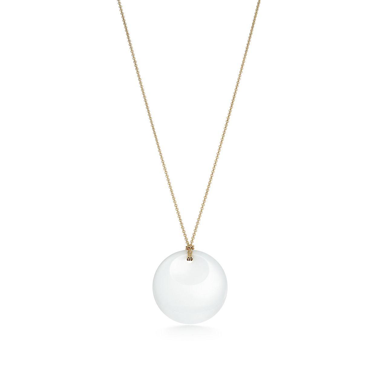 Lovely Elsa Peretti® Round pendant of white jade and 18k gold. | Tiffany  AH07