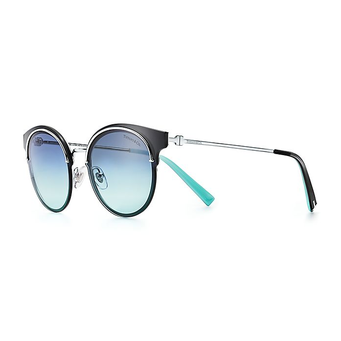 0fe80afe2b99 Tiffany T round sunglasses in silver-colored metal.