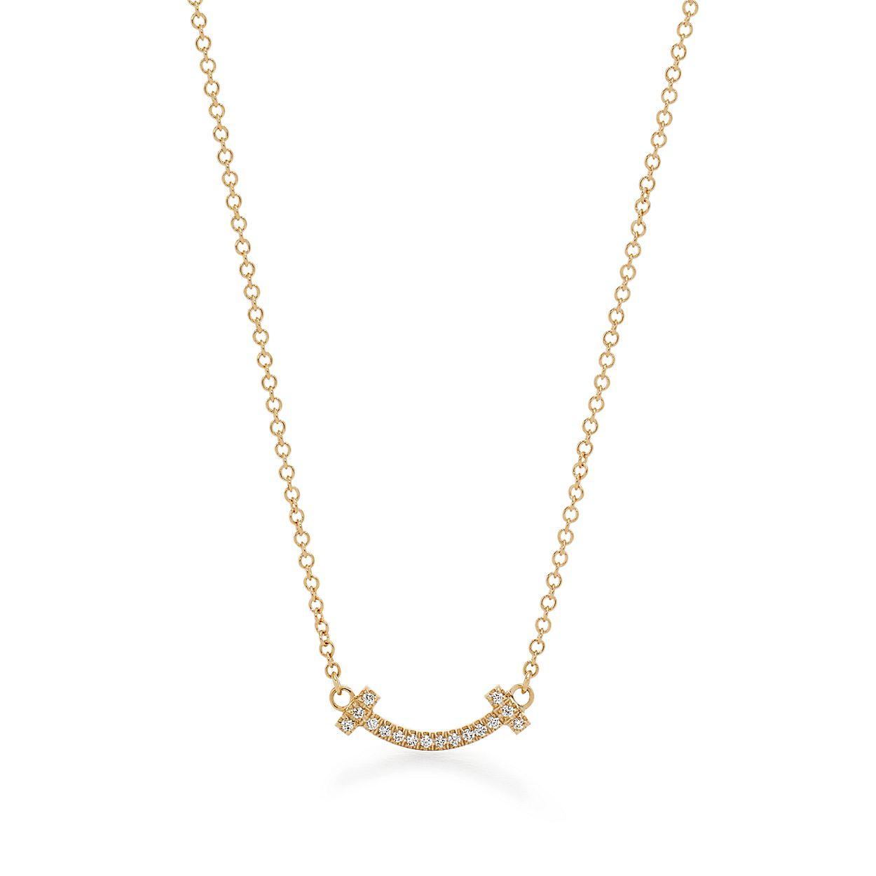 Pendente Smile Tiffany T em ouro 18k com diamantes, micro.   Tiffany ... f11590a0b4