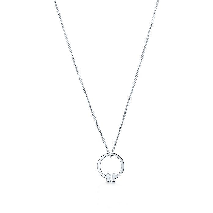 e5f2838b4 Tiffany T square pendant in 18k white gold with a baguette diamond ...