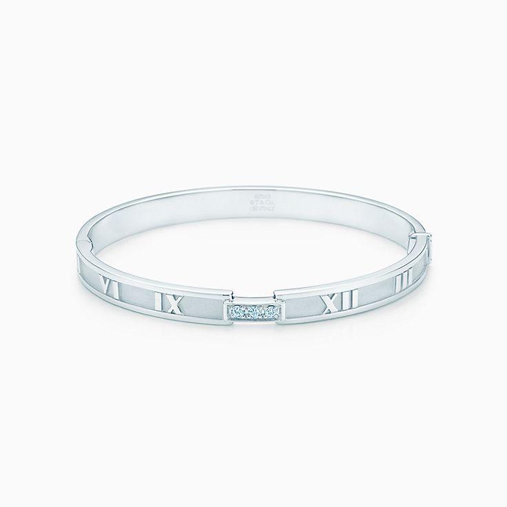 496aeb45a Atlas® closed hinged bangle in 18k white gold with diamonds, medium. |  Tiffany & Co.