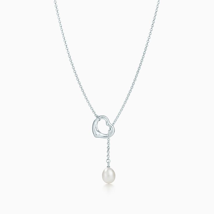 1f7541d67 Elsa Peretti® Open Heart lariat in sterling silver with a freshwater pearl.  | Tiffany & Co.