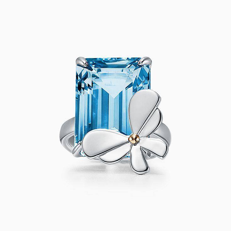 Return to Tiffany™ Love Bugs:Anillo de mariposa con topacio azul en plata de ley y oro rosa de 18 ct