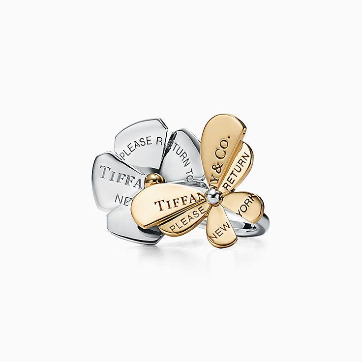 Return to Tiffany™ Love Bugs:Anillo de mariposa y flor en plata de ley y oro de 18 ct