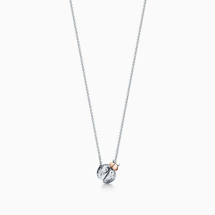 Return to Tiffany™ Love Bugs:Colgante con mariquita en plata de ley y oro de 18 ct
