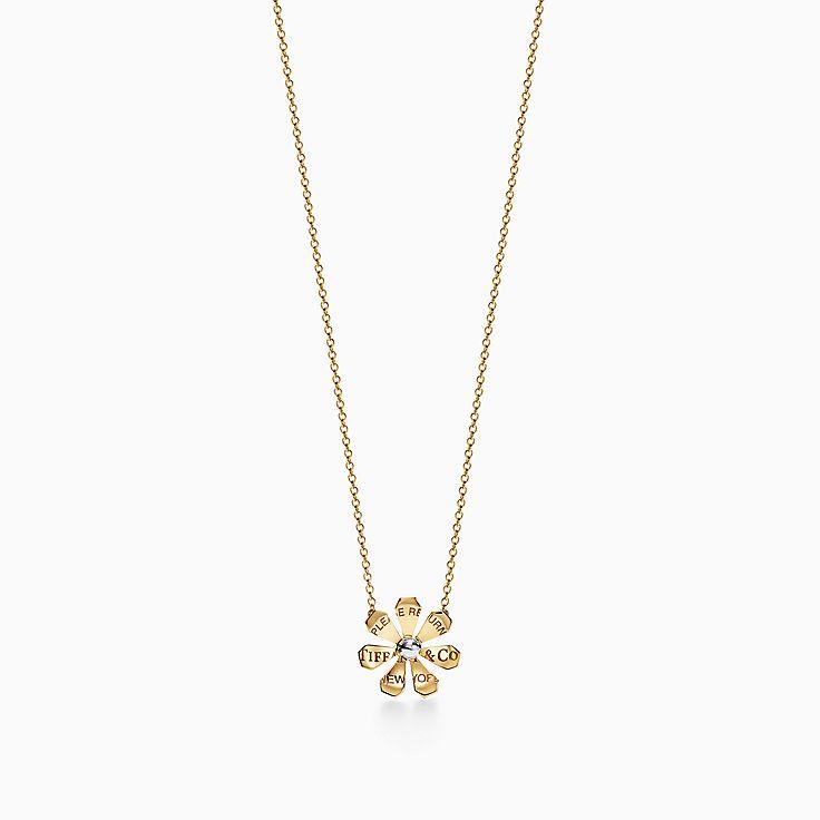 Return to Tiffany™ Love Bugs:Colgante de margarita en oro de 18 ct y plata de ley
